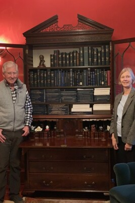 The Ingersolls in front of their bookcase