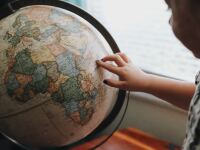 image of a child looking at a world globe