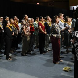 A group of BYUH employees standing together and reciting a Hawaiian welcome chant