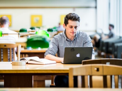 Student at a table with a laptop