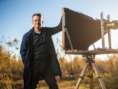 BYU professor Paul Adams poses with tintype camera.jpg