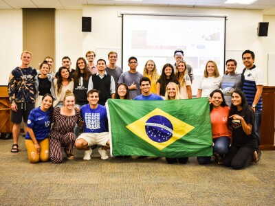 Members of the Latin America Club hold up a Brazil flag