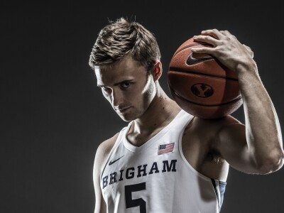 Image of BYU Men's Basketball player holding a ball.