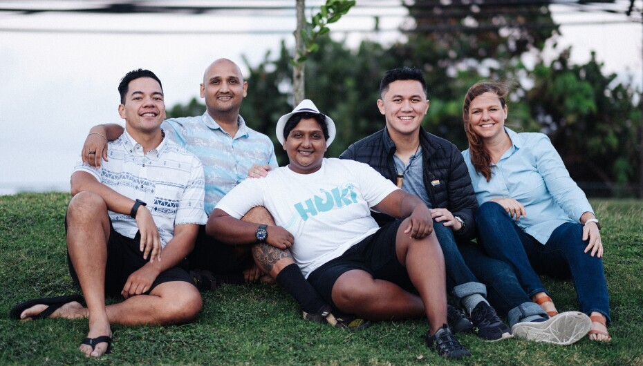 Members of Affirmation Hawaii take a picture together outside on the grass.