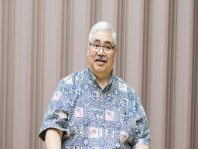 John Tsukayama wearing a Hawaiian shirt