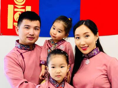 A Mongolian family dressed in traditional clothing celebrates Lunar New Year