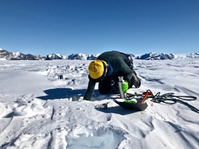 Spencer Ingley collects snow samples in Antarctica.