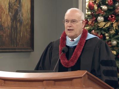 Elder Paul V. Johnson in academic robes