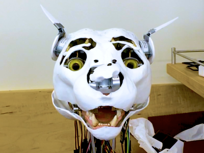 Skeleton of an animatronic cougar head