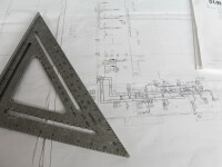 Architectural plans and right angle triangle ruler.