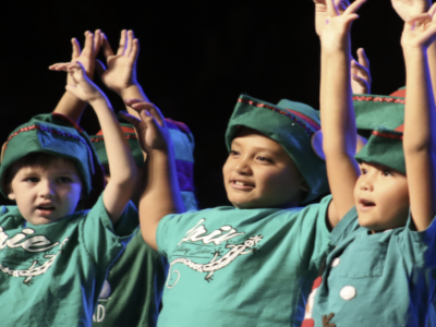 Children from Laie Elementary School sing while dressed up in Christmas outfits
