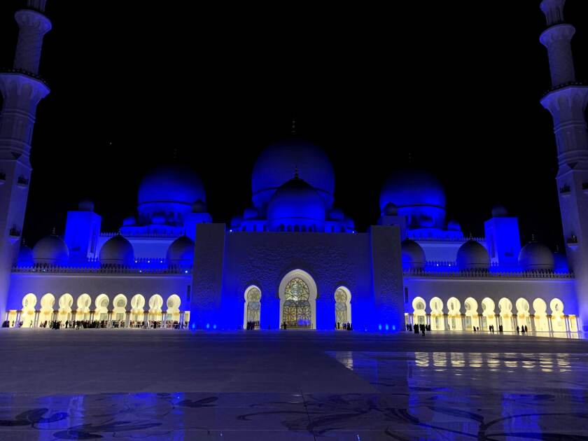 The Grand Mosque at night in Abu Dhabi.