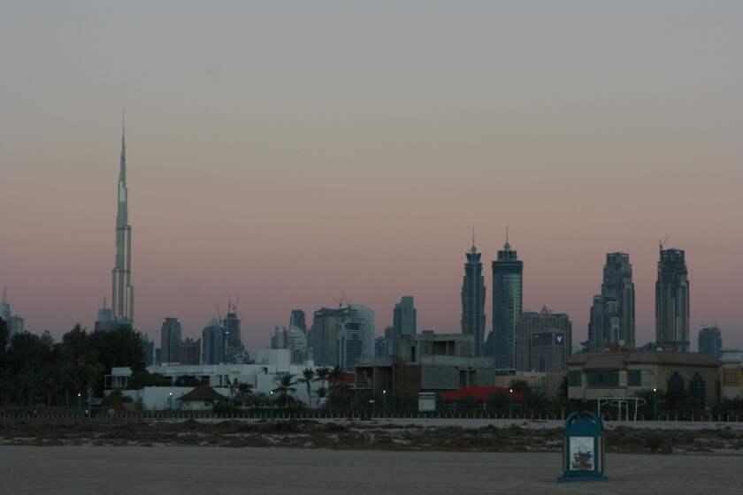 The Dubai skyline with the Burj Khalifa towering above all the buildings.