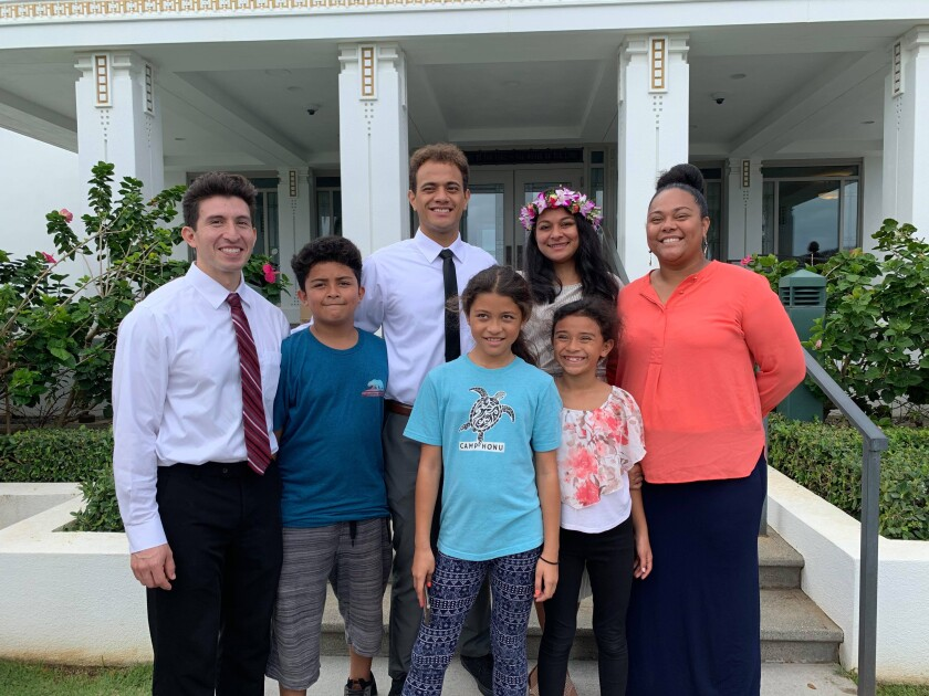 The Garcia family and friends standing in front of the Latter-Day Saints temple.