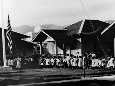 A photo of a flag-raising ceremony at the Laie school.