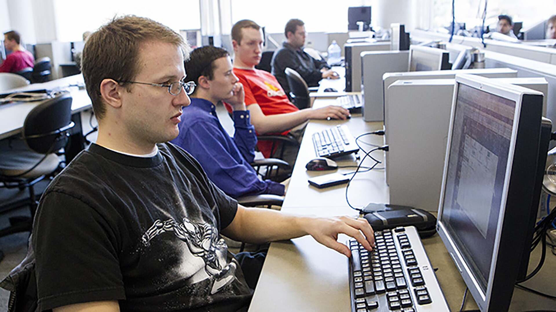Several IT students working in a computer lab