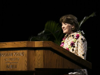 Portrait of Sister Susan W. Tanner at podium