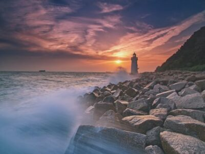 An image of a lighthouse in a sunset