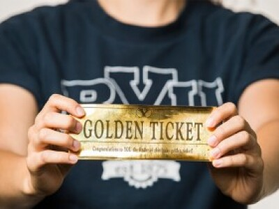 a close-up view of a Golden Ticket that says Congratulations to you the finder of the Golden Ticket
