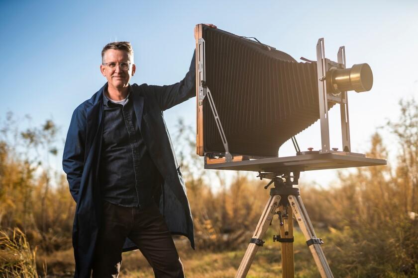 BYU professor Paul Adams poses with tintype camera.jpg