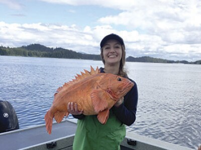 Haley Brown with big orange fish