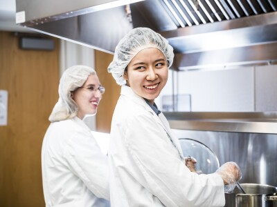 NDSF sensory lab students in white and hair nets.jpg