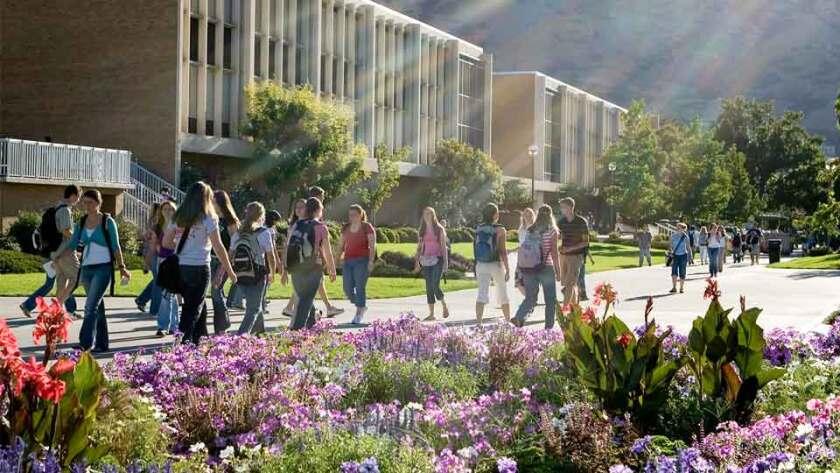 Image of people walking across campus.
