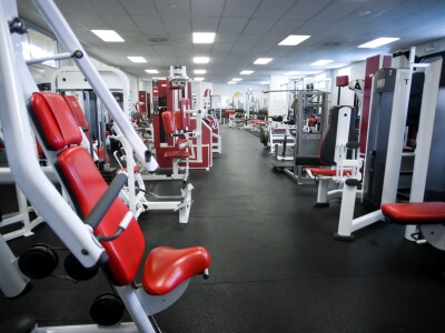 Photo of the inside of the fitness with lots of various exercises machines
