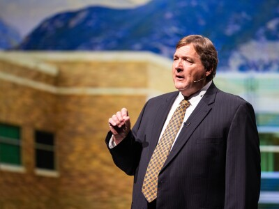 Steve Smith, BYU Student Development Services executive director, delivers a devotional address to campus.