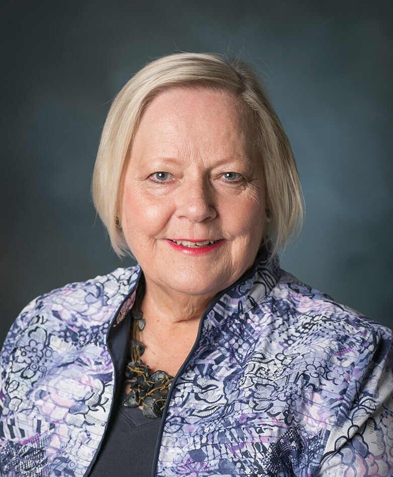 Picture of Professor Hennonen with blue-black background.