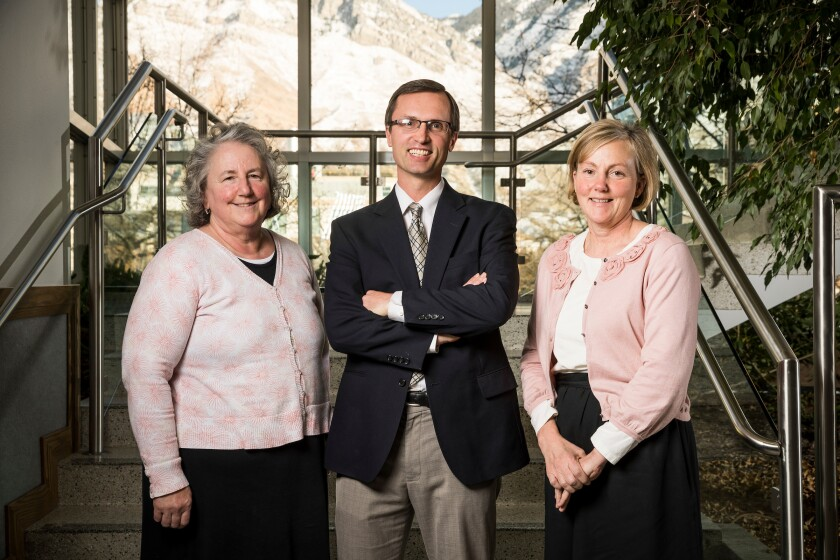 Melissa Heath, Timothy Smith and Ellie Young in the McKay Education Building