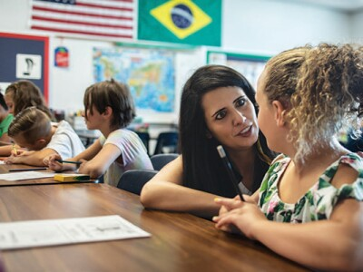 Dual Language Immersion alumni, Lilly Bueno, teaches a student in her classroom.
