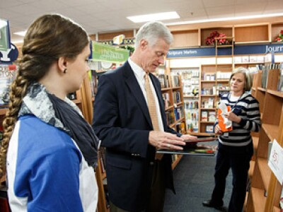 President Worthen picking out a Christmas book at the BYU bookstore