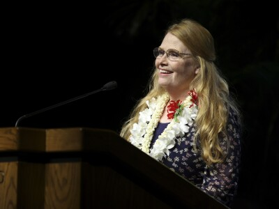 Sister Rasmussen standing at the podium.