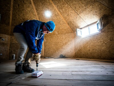 Man working on installing a floor