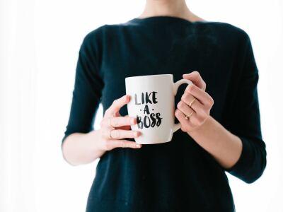 "Girl holding a ""like a boss"" mug"