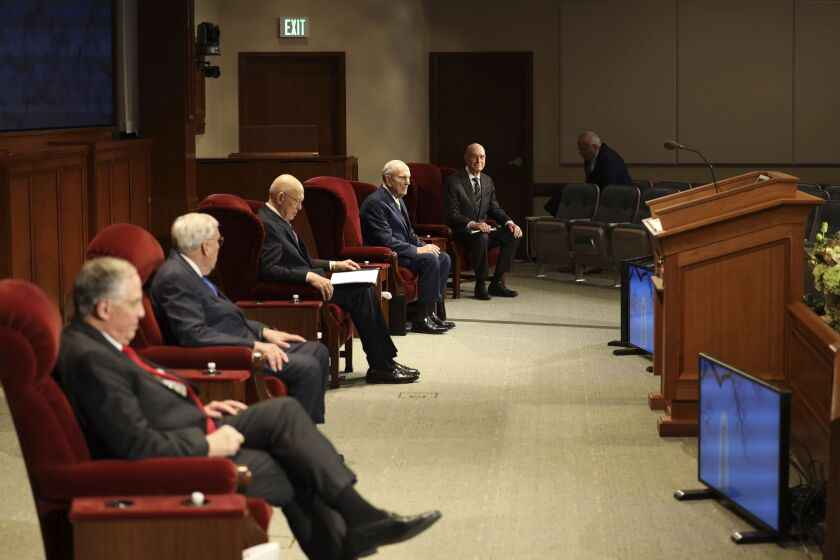 Speakers practicing social distancing for the April 2020 General Conference sit in chairs in a conference room on the grounds of Temple Square in Salt Lake City, Utah.