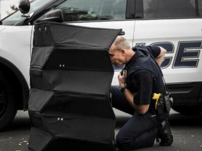 Picture of Police Officer taking cover