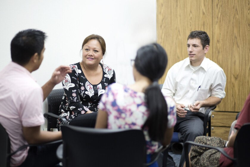 Photo of several people in a group therapy circle