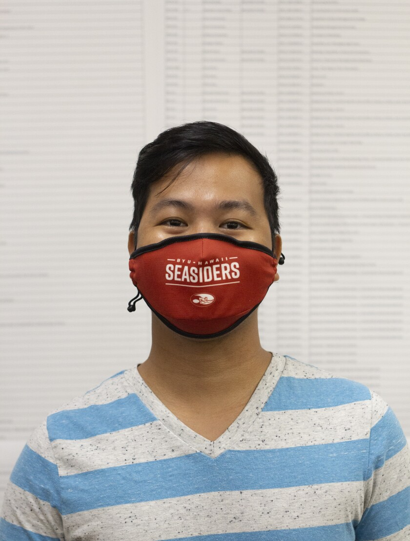 "Santiago wearing a grey and blue striped shirt with a red mask saying ""seasiders."""