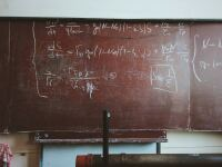 image of math formulas on a blackboard