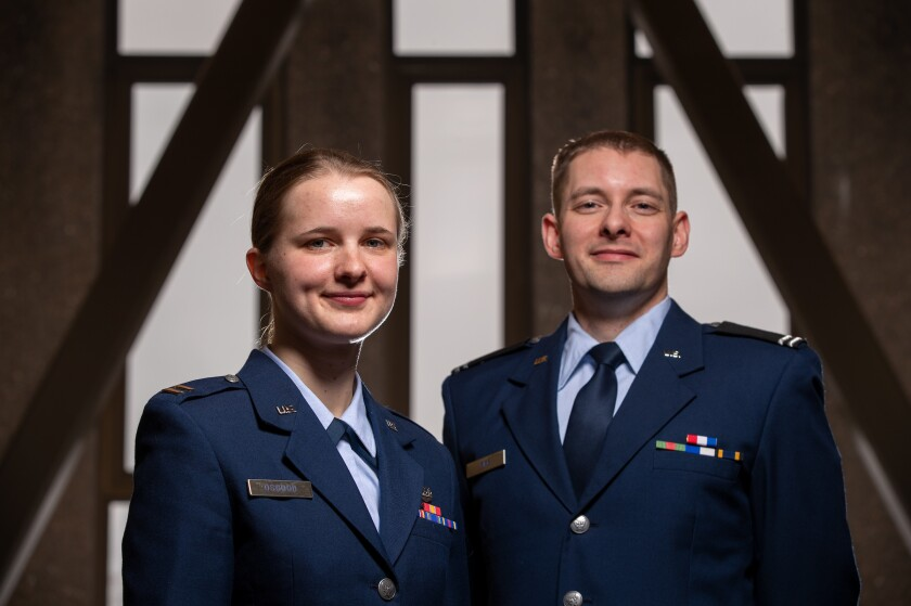 Image: Karina Osgood and Matt Fife in uniform.