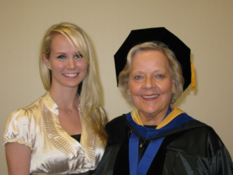 Hannonen in academic garb with BYUH woman