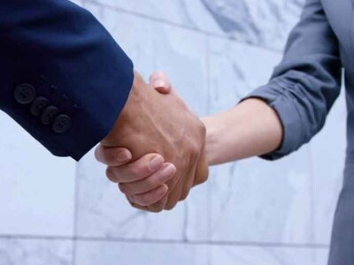 People Shaking hands in the Marriott School of Business