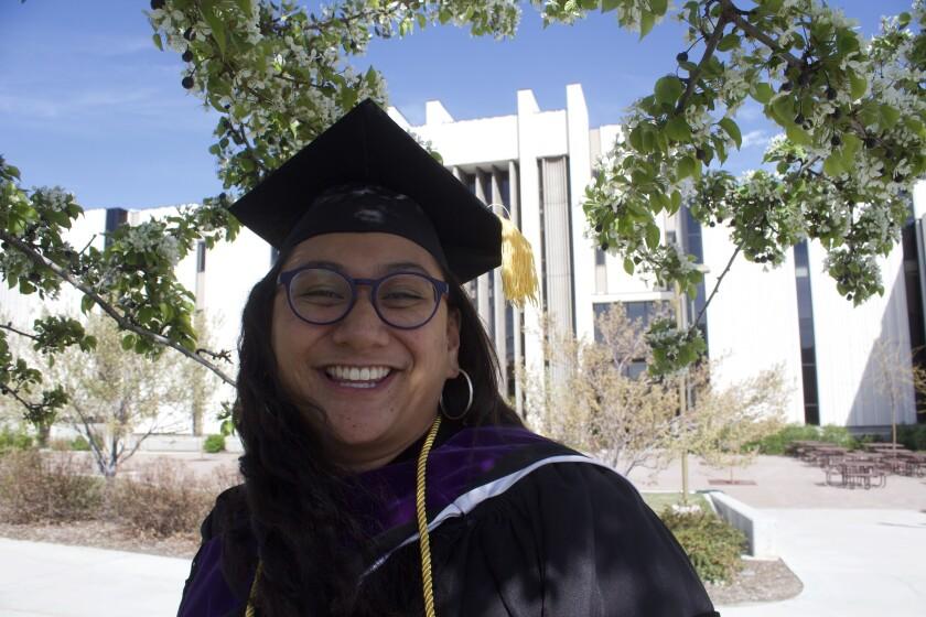 Sala McCarthy-Stonex dressed in graduation clothes at BYU.