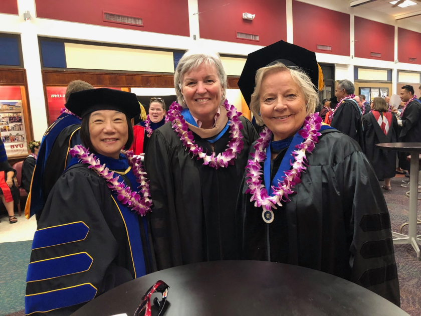 Professor Hannonen stands next to faculty members in academic gowns and medals.