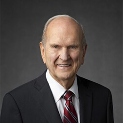 Russell M. Nelson in black suit and red tie