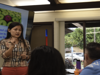 Dr. Barbara Hong instructs students and parents in a classroom
