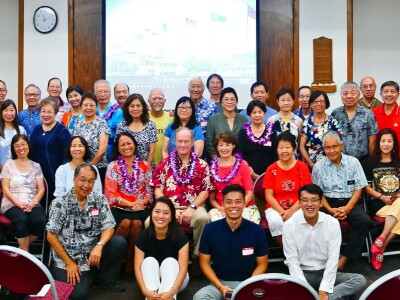 Members from the Global Chinese Alumni Chapter lined up and seated at the 2019 BYU Hawaii reunion.