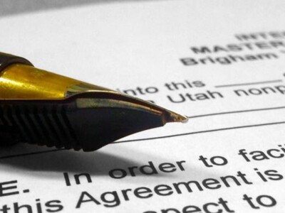 Pen on top of a blank internship master agreement (contract)